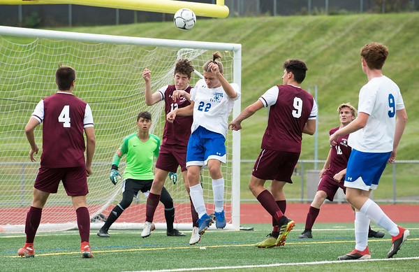 10/07/19 Wesley Bunnell | StaffrrBristol Eastern and Bristol Central played to a 1-1 tie in their match at Bristol Central High School on Monday afternoon. Bristol Central's Andrew Oren (12) and Eastern's Kyle Cyr (22) go up for a header.