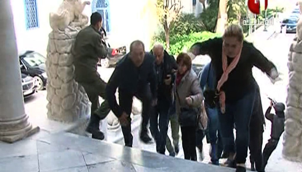 . An image grab taken from the state-run Tunisia 1 channel on March 18, 2015 shows people escaping from Tunis\' famed Bardo Museum during an attack by two men armed with assault rifles. Two gunmen who attacked a museum in the heart of the Tunisian capital have been killed as well as a policeman, state television said, without specifying if the incident was over.  AFP PHOTO / AFP PHOTO / TUNISIAN 1/AFP/Getty Images
