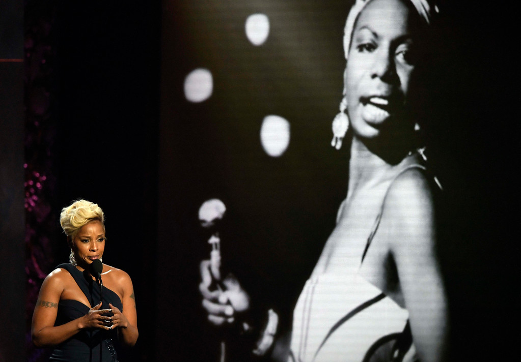 . Presenter Mary J. Blige honors Nina Simone during the Rock and Roll Hall of Fame induction ceremony, Saturday, April 14, 2018, in Cleveland. (AP Photo/David Richard)