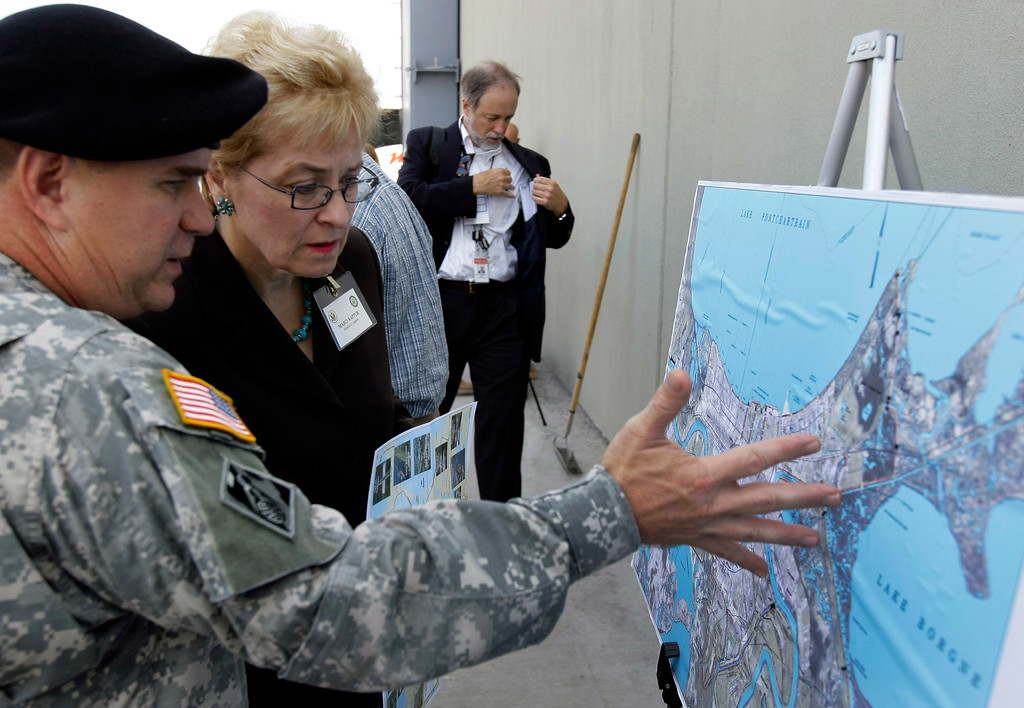 """. Rep. Marcy Kaptur, D-Ohio, second from left, talks with U.S. Army Corps of Engineers Col. Alvin \""""Al\"""" Lee during a congressional leaders tour of the damage and construction efforts after Hurricane Katrina, Monday, July 21, 2008, in Harvey, La. (AP Photo/Alex Brandon)"""