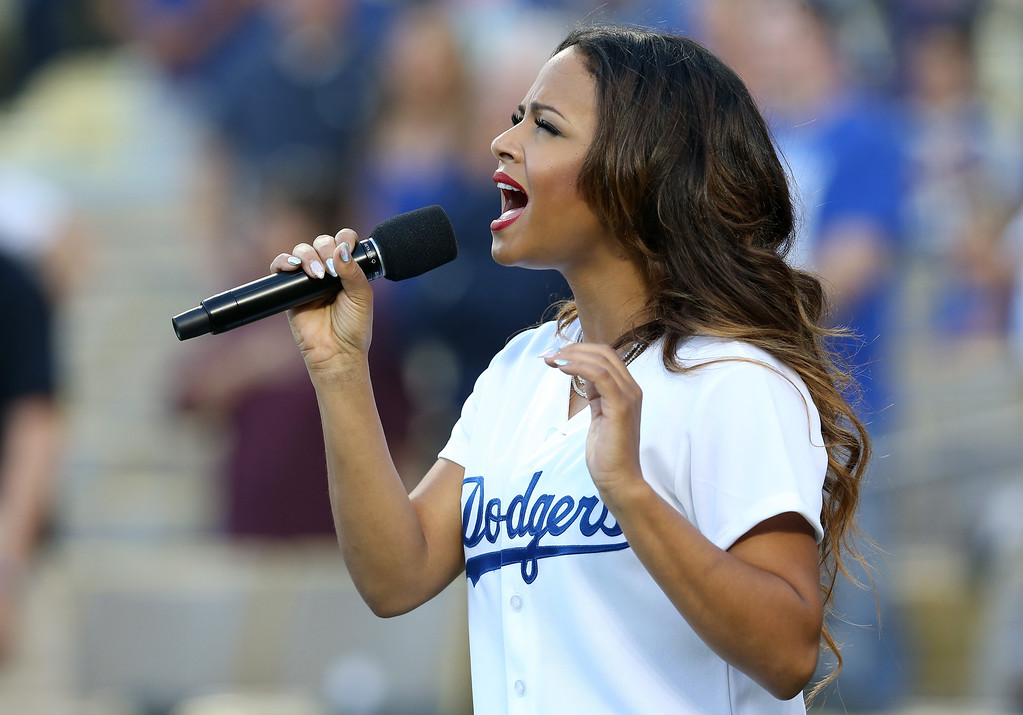 . Christina Milian sings the national anthem bfore the game between the Colorado Rockies and the Los Angeles Dodgers at Dodger Stadium on September 27, 2014 in Los Angeles, California.  (Photo by Stephen Dunn/Getty Images)