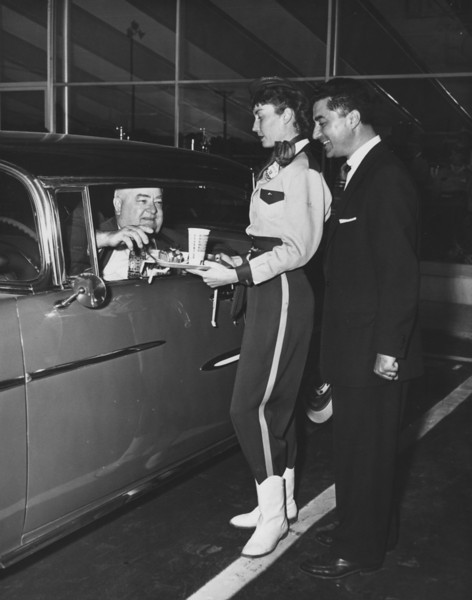 Mayor Edward Biertuempfel gets VIP treatment at The Adventure Car Hop as owner John Skugaras evaluates his employee in this 1956 shot. This could be the grand opening.