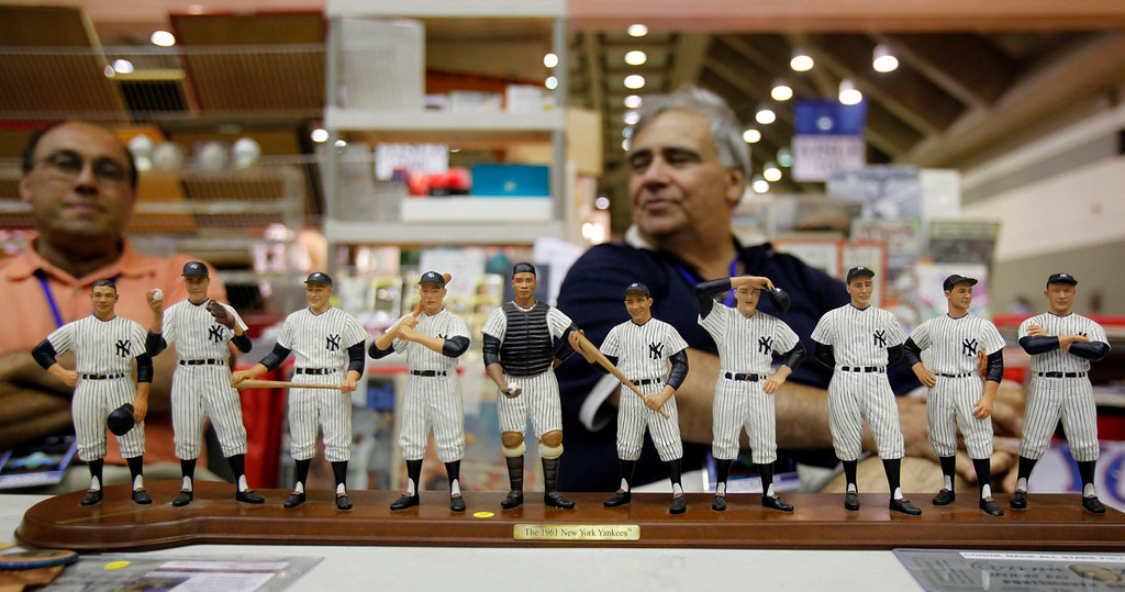 . Vendors Phil Caponegro, left, and Frank Korzeniewski of Brooklyn, N.Y., sit in front of a sculpture they are selling of the 1961 New York Yankees at the 2010 National Sports Collectors Convention in Baltimore. The National Sports Collectors Convention is in Cleveland beginning through Aug. 5 at the I-X Center. If there�s a piece of sports memorabilia you desire, it�s likely you�ll find it among the 650 dealers expected to be in attendance at the biggest show of the year in the United States. For more information, visit nsccshow.com/convention-tickets-vip-registration. (Associated Press file)