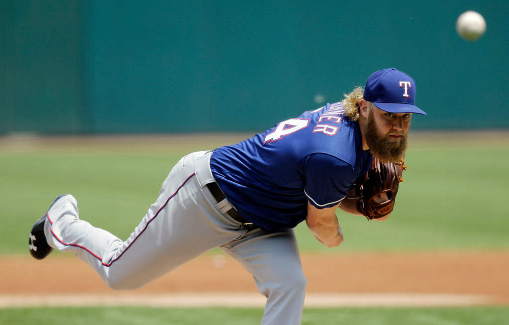 . Texas Rangers starting pitcher Andrew Cashner delivers in the first inning of a baseball game against the Cleveland Indians, Thursday, June 29, 2017, in Cleveland. (AP Photo/Tony Dejak)