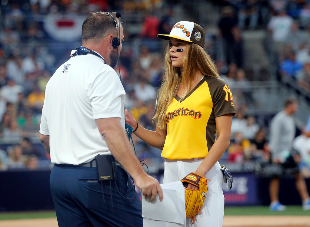 . Model Nina Agdal is told she has to catch during the All-Star Legends & Celebrity Softball game, Sunday, July 10, 2016, in San Diego. (AP Photo/Lenny Ignelzi)