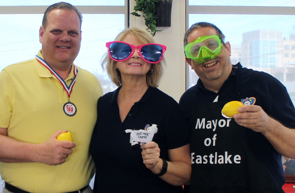 . Kristi Garabrandt � The News-Herald <br> Willowick Mayor Rich Regovich, Miracle League of Lake County Director Judy Moran, and Eastlake Mayor Dennis Morley pose together after the Lemon Squeeze Battle to raise funds for The Miracle League.