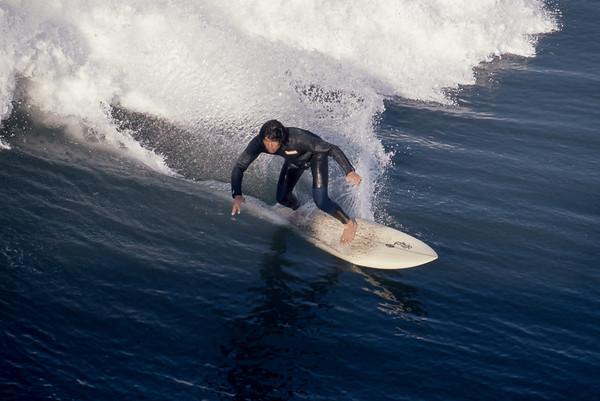 Surfing at the Huntington Beach pier California 1971