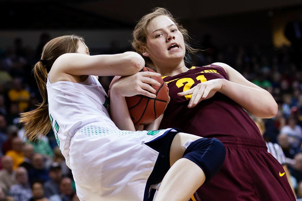 . Notre Dame guard Madison Cable, left, and Arizona State forward Sophie Brunner (21) battle for the ball during the second half in a second-round game in the NCAA women\'s college basketball tournament in Toledo, Ohio, Monday, March 24, 2014. (AP Photo/Rick Osentoski)