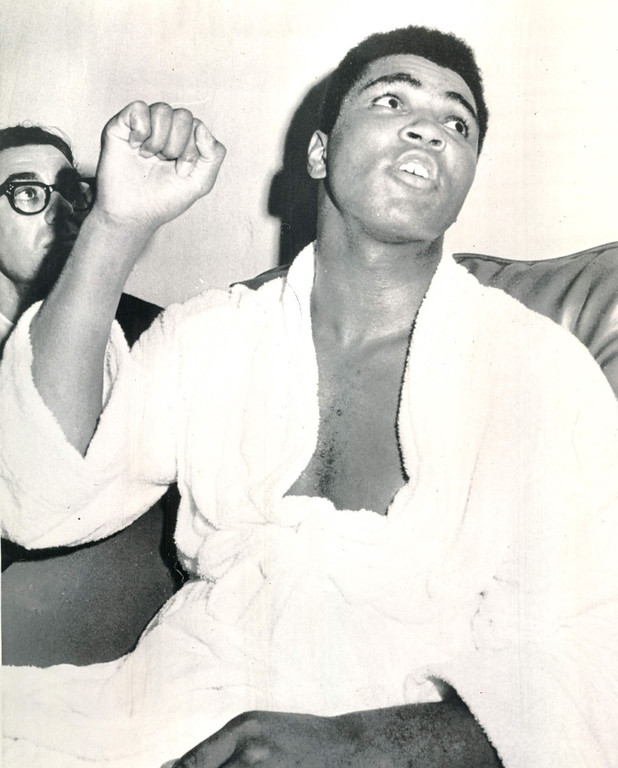 """. Heavyweight champion Cassius Clay tells dressing room crowd.  \""""My plan for the fight was to punch--and you saw it,\""""  after he defeated challenger Cleveland Williams on a technical knockout in Houston\'s Astrodome tonight.  Clay also credited his \'Ali shuffle\' for aiding him in downing Williams four times in the three round fight.  1966. Credit: AP"""