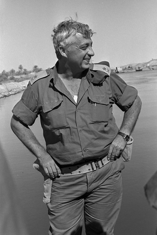 . In this handout from the Israeli Governmental Press Office, Southern Command General Ariel Sharon stands on the banks of the Suez Canal in the Sinai Desert during the Yom Kippur War October 31, 1973 in Egypt. (Photo by Ron Ilan/GPO via Getty Images)