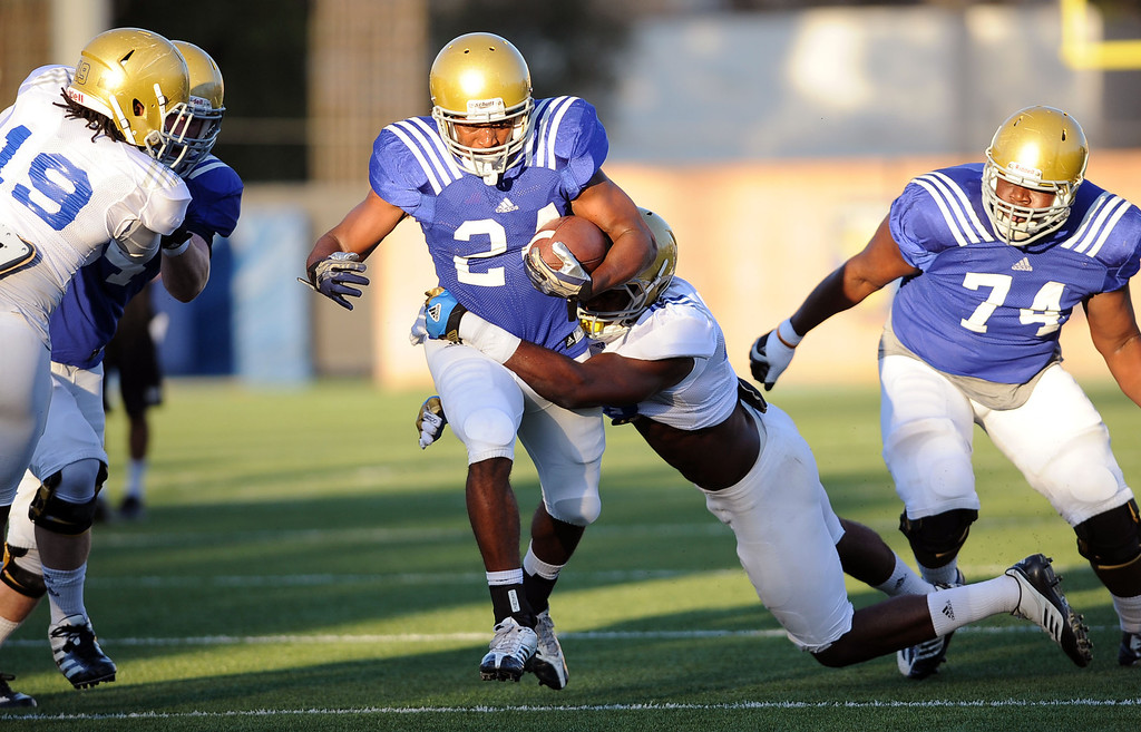 . Paul Perkins carries the ball during spring practice Monday April 7, 2014 at UCLA.(Andy Holzman/Los Angeles Daily News)