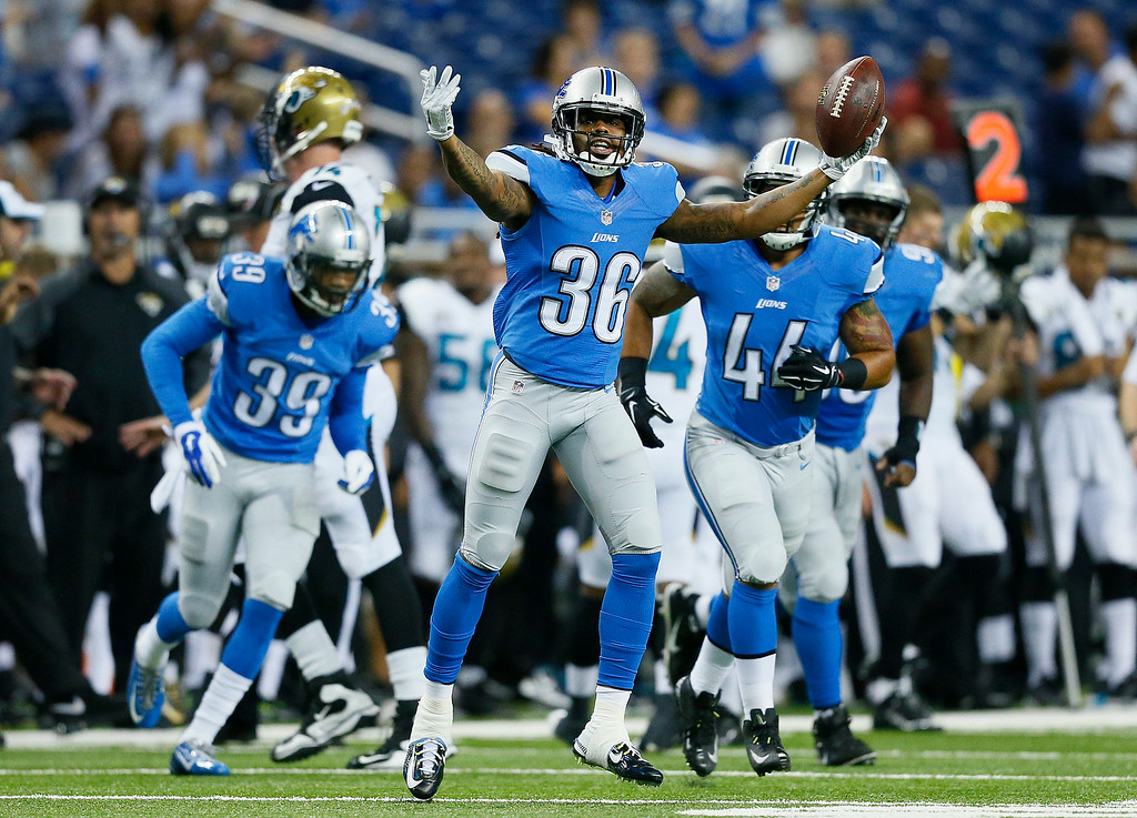 . Detroit Lions cornerback Jonte Green (36) celebrates intercepting a Jacksonville Jaguars quarterback Ricky Stanzi pass in the second half of a preseason NFL football game at Ford Field in Detroit, Friday, Aug. 22, 2014. (AP Photo/Rick Osentoski)