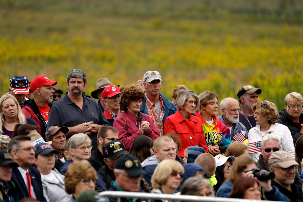 . Family members and guests attend the September 11th Flight 93 Memorial Service, Tuesday, Sept. 11, 2018, in Shanksville, Pa. President Donald Trump is marking 17 years since the worst terrorist attack on U.S. soil by visiting the Pennsylvania field that became a Sept. 11 memorial.  (AP Photo/Evan Vucci)