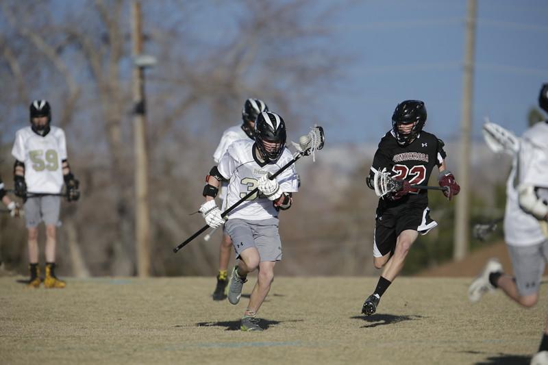 JPM0060-JPM0060-Jonathan first HS lacrosse game March 9th.jpg