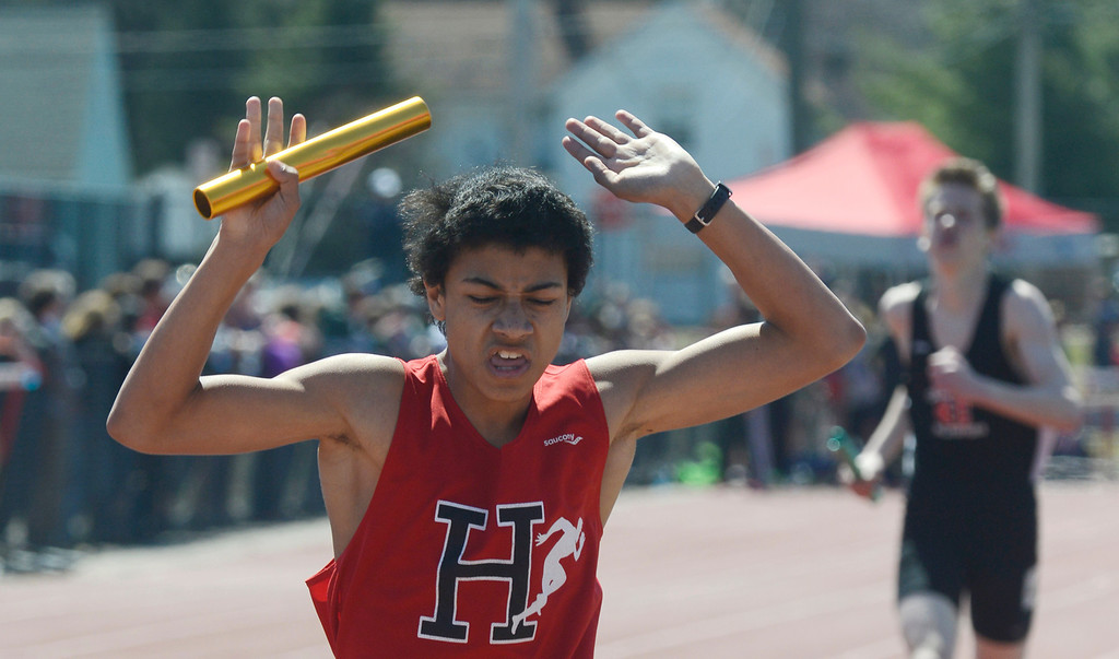 . Maribeth Joeright/MJoeright@News-Herald.com<p> Harvey anchor Deondre Martin reacts as he crosses the finish line, helping his team to victory in the boys 4X800 meter relay during the Hilltopper Invitational track meet at Chardon High School.