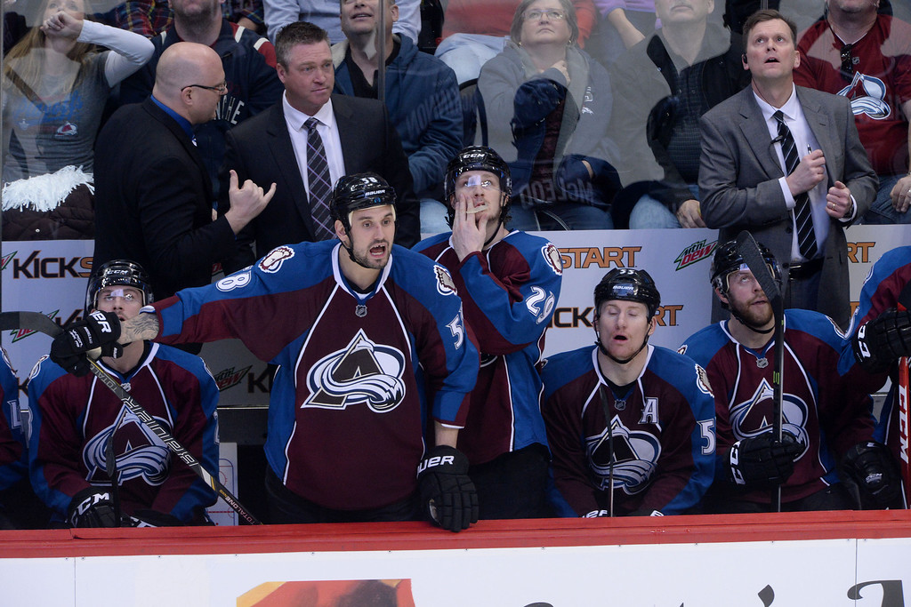 . The Colorado Avalanche watches their teammates on the ice against the Minnesota Wild during the second period of action. The Colorado Avalanche hosted the Minnesota Wild in the first round of the NHL playoffs at the Pepsi Center on Thursday, April 17, 2014. (Photo by Karl Gehring/The Denver Post)