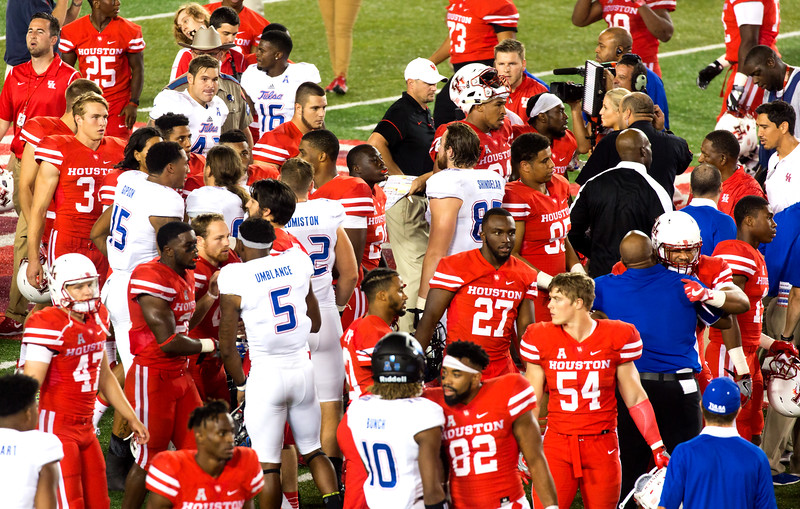 Then they remember to shake hands with Tulsa.  Coach Herman, upper center.