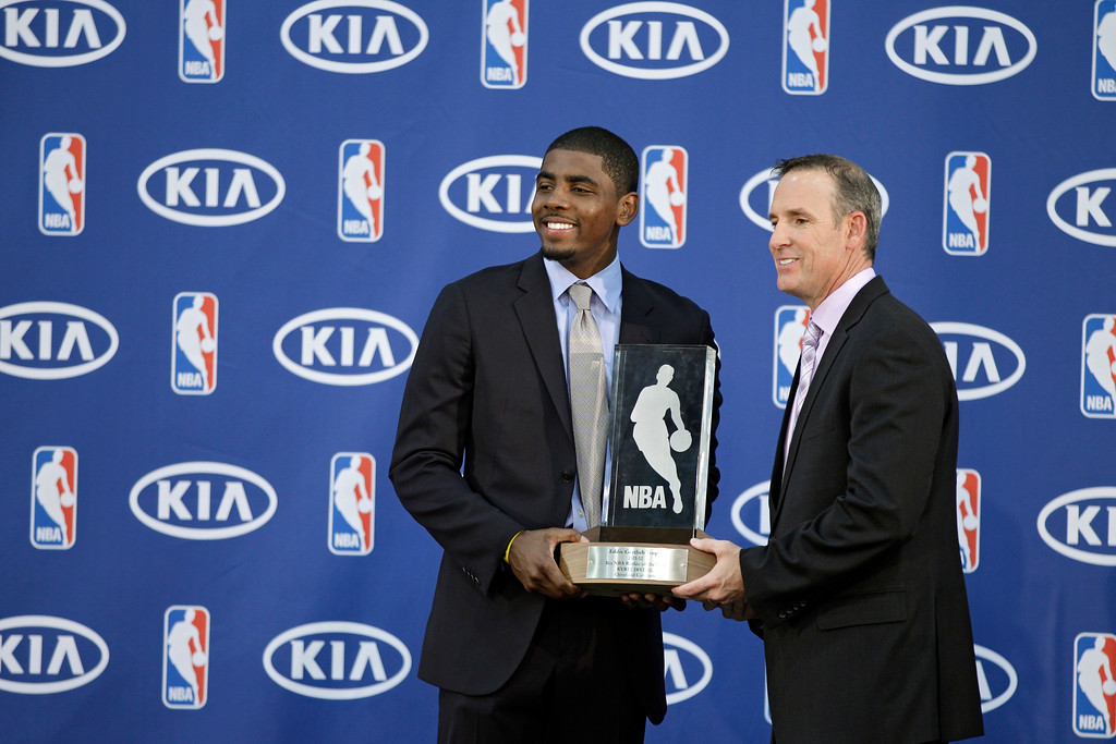 . Cleveland Cavaliers\' Kyrie Irving, left, poses with the NBA Rookie of the Year award with Kia Motors America regional director Mike Helgesen at the basketball team\'s headquarters in Independence, Ohio Tuesday, May 15, 2012. (AP Photo/Mark Duncan)