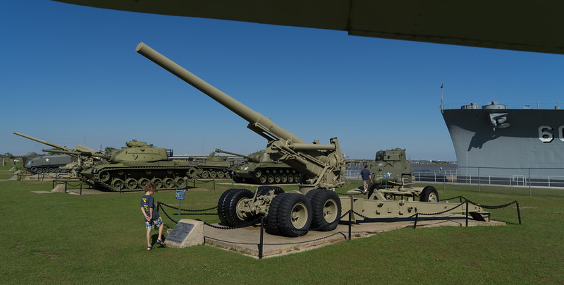"""U.S. Army """"Long Tom"""" 155mm towed howitzer, with M60 tank to its left rear."""