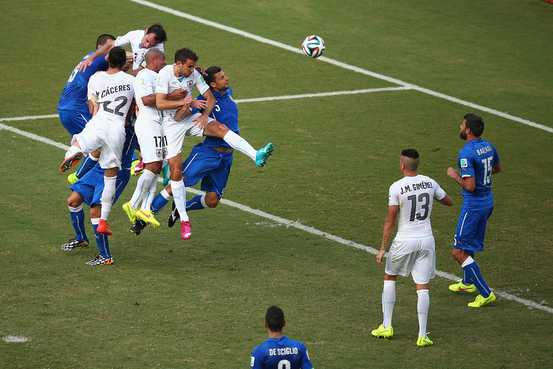 . Diego Godin of Uruguay  goes up for a header and scores his team\'s first goal during the 2014 FIFA World Cup Brazil Group D match between Italy and Uruguay at Estadio das Dunas on June 24, 2014 in Natal, Brazil.  (Photo by Julian Finney/Getty Images)