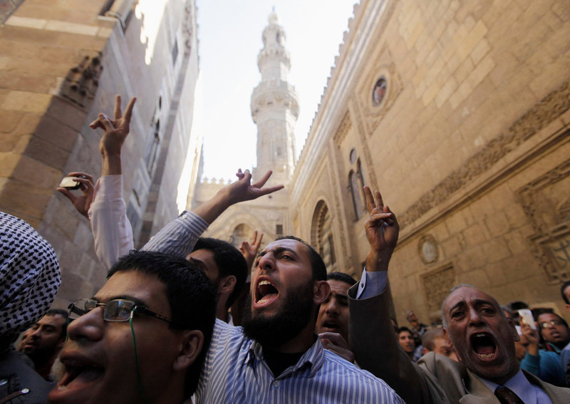 . Supporters of Egyptian President Mohamed Mursi and members of the Muslim Brotherhood shout slogans during the funerals for fellow supporters of Mursi who died in recent clashes at the presidential palace according to local media, at Al Azhar mosque in Cairo December 7, 2012. The crisis unleashed by Mursi\'s bid to wrap up Egypt\'s transition on his own terms has eroded his nation\'s faith in their nascent democracy and will complicate the already unenviable task of government. REUTERS/Amr Abdallah Dalsh
