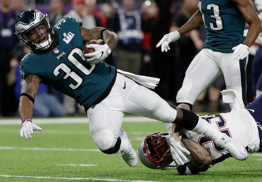 . Philadelphia Eagles\' Corey Clement is stopped by New England Patriots\' Patrick Chung after catching a pass during the first half of the NFL Super Bowl 52 football game Sunday, Feb. 4, 2018, in Minneapolis. (AP Photo/Matt Slocum)