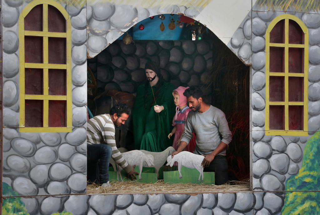 . Christians arrange the Nativity scene in an enclosure at St. Anthony\'s church in preparation for Christmas, in Lahore, Pakistan, Thursday, Dec. 21, 2017. (AP Photo/K.M. Chaudary)