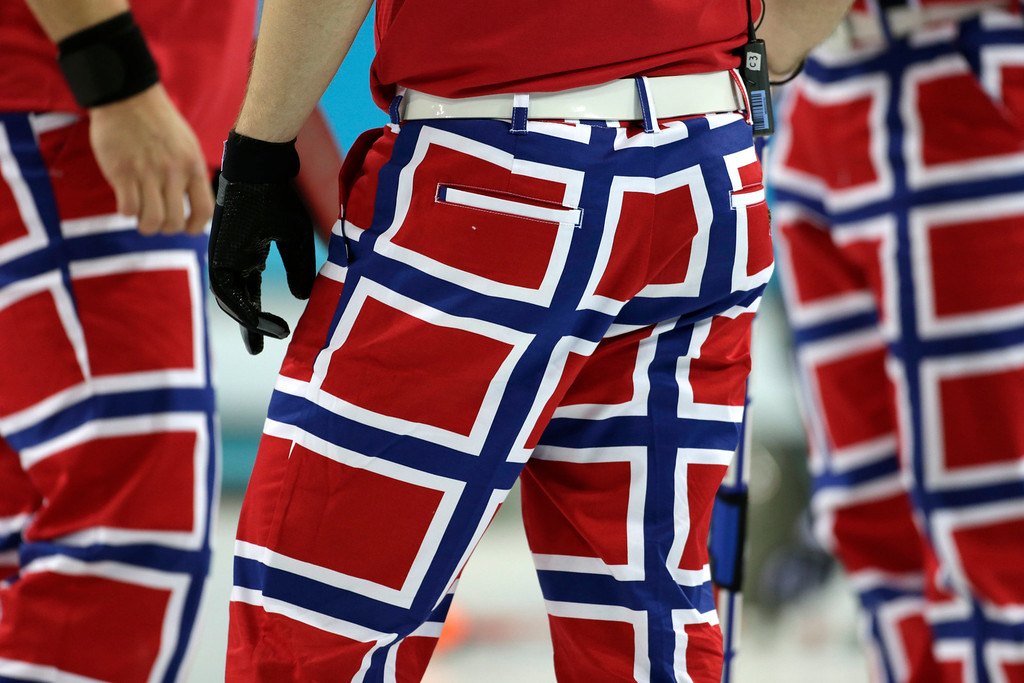 . The Norway curling team\'s latest pants design, inspired by the country\'s flag, are seen during competition at the 2014 Winter Olympics, Thursday, Feb. 13, 2014, in Sochi, Russia. (AP Photo/Robert F. Bukaty)