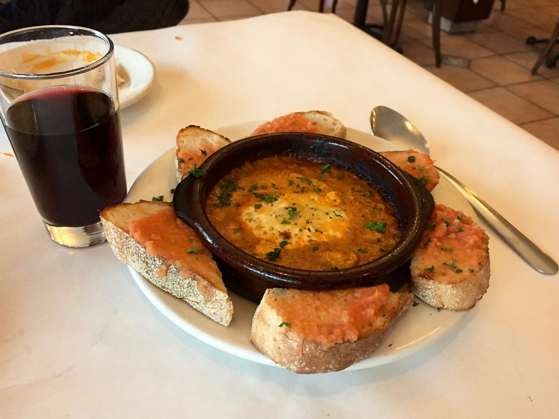 Queso de Cabra al Horno - herbed goat cheese baked in tomato basil sauce, toasted baguettes w/tomato, olive and garlic puree.