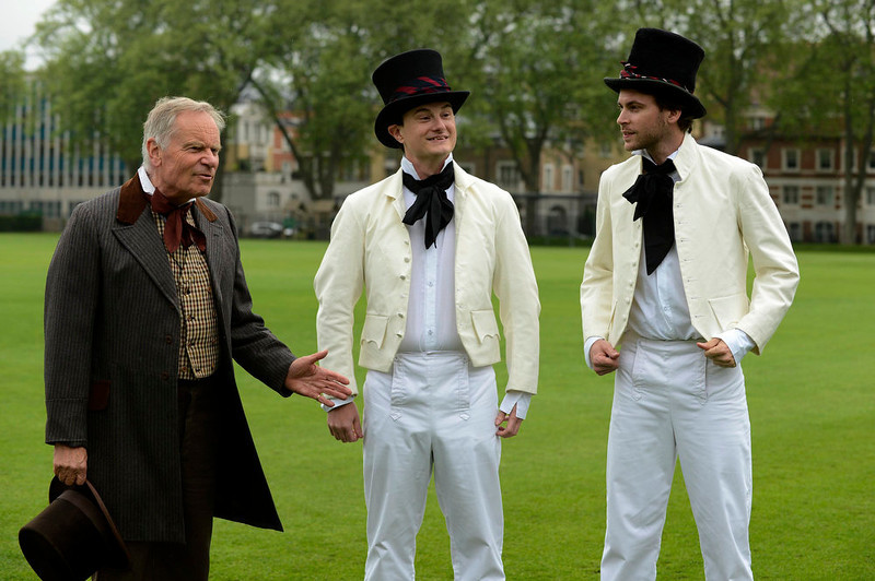 . Author Jeffrey Archer (L-R) talks to Jarrod Kimber and Sam Collins before a Victorian Cricket match to commemorate the 150th anniversary of Wisden Cricketers\' Almanack at Vincent Square in London May 29, 2013. REUTERS/Philip Brown