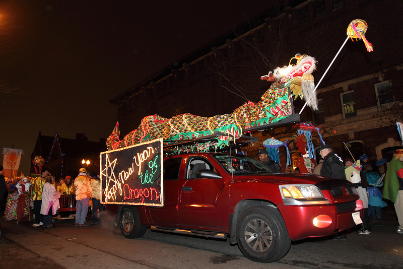 """Polices came and told us generator is no longer allowed to use in parade meaning that the """"Happy New Year of the Dragon"""" on side and the dragon on top of the car will not be lit. Although no lights on the car we still one of the shiniest in the parade! Copyright 2012 By Chi-Sun Chan"""