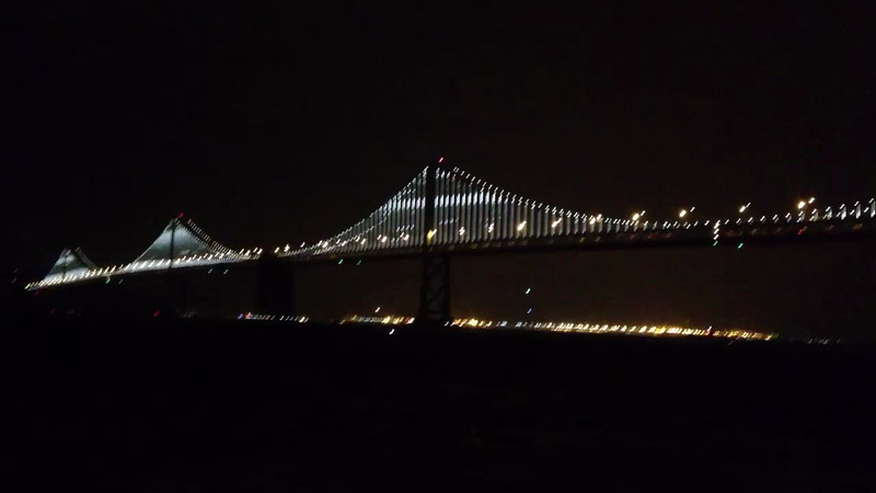 Bay Bridge Lighting Ceremony.  Shot this shaky video with my iPhone while holding an umbrella to protect Vince's camera.