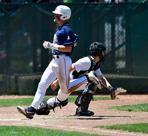 6/8/2019 Mike Orazzi | Staff Staples High School's Zachary Zobel (1) scores as Southington's Jacob DelMonte (2) covers home during the Class LL State Baseball Tournament at Palmer Field In Middletown on Saturday.