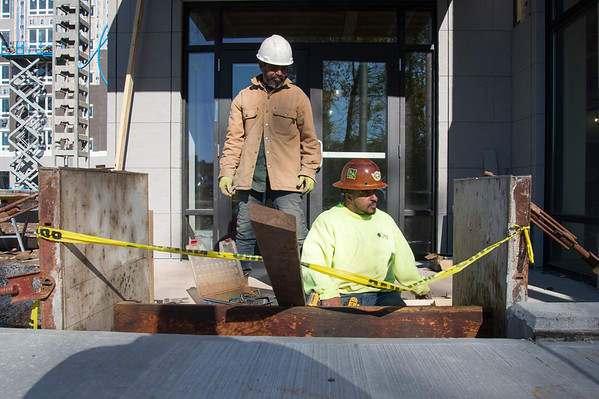 10/21/19 Wesley Bunnell | StaffrrArtur Cardoso from Rutra's Concrete works on steps to an entranceway to the Columbus Commons on Columbus Blvd on Monday afternoon. The building has an anticipated completion date of mid January 2020.