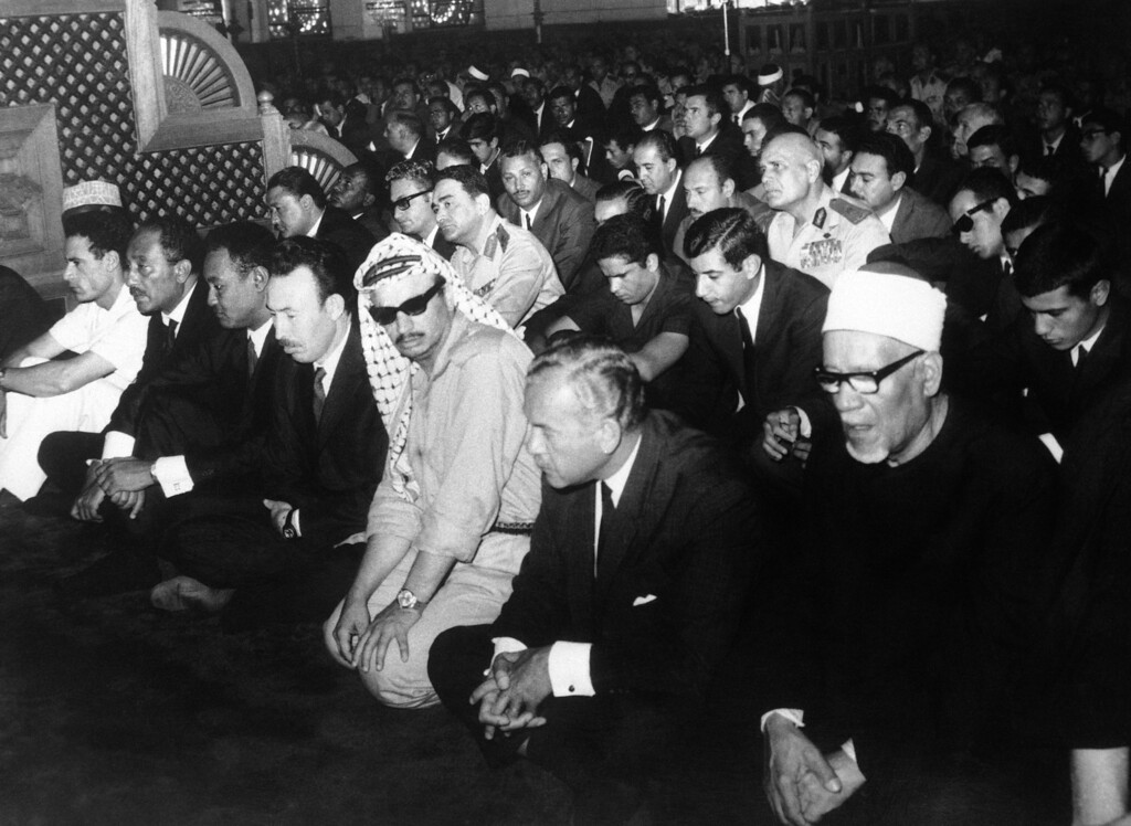 . Praying at the Nasser Mosque in Cairo, Egypt for the late President Gamal Abdel Nasser, on Oct. 2, 1970, from left are; Libyan Head of State, Moammer Gadhafi; United Arab Republic Provisional President Anwar El Sadat; Sudan Head of State, Gaafar Nimeiry; Algerian President Houari Boumediene; Palestinian Liberation Organization leader, Yasser Arafat; Hussein El Shafey, member of Supreme Executive Committee of Arab Socialist Union; Sheikh Mohammed Faham, Rector of Al Azhar University. In second row, at either side of the head of Faham, are two sons of late President Nasser, Abdel Hakim, right, and Khalid Abdel Nasser, left. (AP Photo)