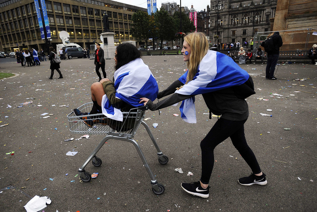 . Pro-independence supporters push each other in a shopping trolley in Glasgow, Scotland, on September 19, 2014, following a defeat in the referendum on Scottish independence. Scotland rejected independence on Friday in a referendum that left the centuries-old United Kingdom intact but paved the way for a major transfer of powers away from London.   AFP PHOTO / ANDY Buchanan/AFP/Getty Images