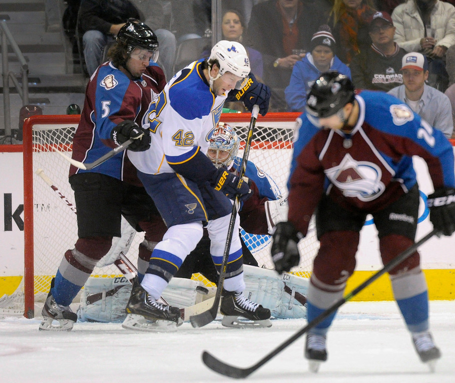 . Colorado defenseman Nate Guenin (5) tried to push St. Louis center David Backes (42) off the puck in the first period.     Photo By Karl Gehring/The Denver Post