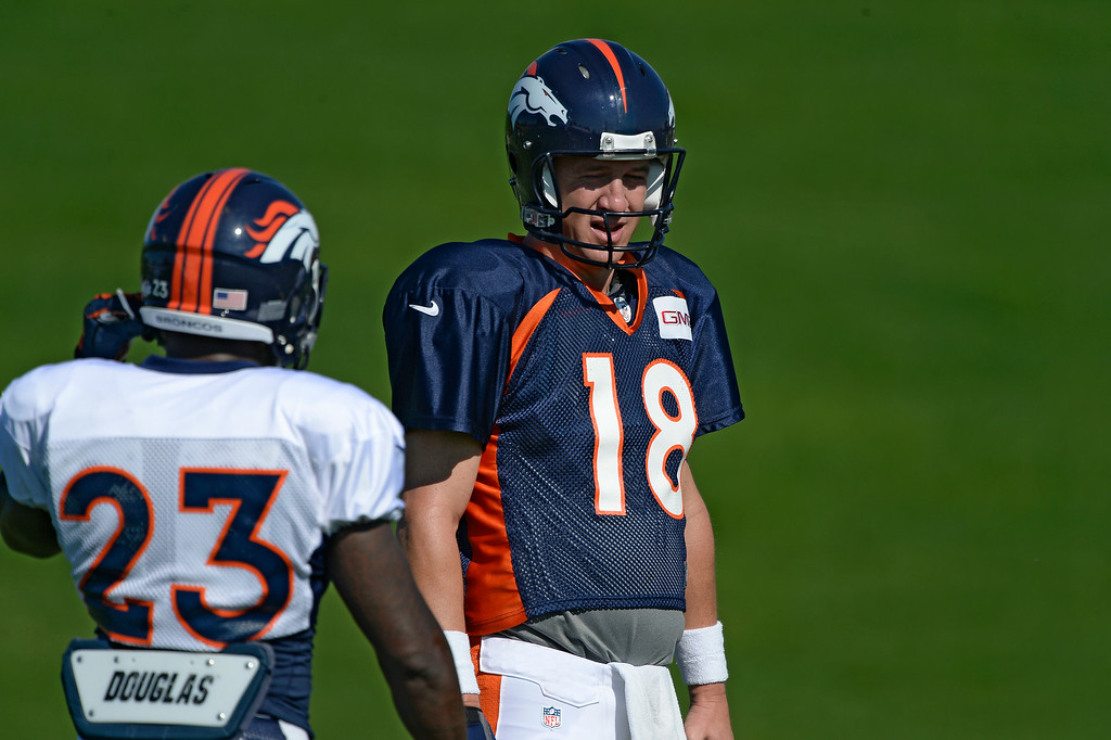 . Denver Broncos quarterback Peyton Manning (18) runs through drills during practice at the Denver Broncos 2014 training camp August 12, 2014 at Dove Valley. (Photo by John Leyba/The Denver Post)