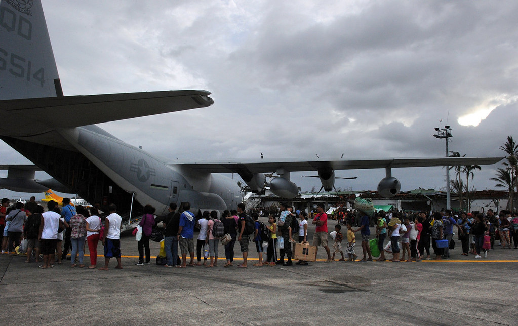 . Survivors of Super Typhoon Haiyan queue up to board a US military C-130 plane for Manila after the plane arrived carrying relief supplies at Tacloban airport in the central Philippines on November 11, 2013, after Super Typhoon Haiyan devastated the city on November 8.  US military planes on November 11 joined a frantic effort to rescue famished survivors of the monster typhoon that may have killed 10,000 people in the Philippines, as local security forces struggled to contain looting.    TED ALJIBE/AFP/Getty Images