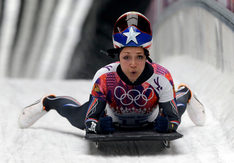 . Katie Uhlaender of the United States brakes after her final run during the women\'s skeleton competition at the 2014 Winter Olympics, Friday, Feb. 14, 2014, in Krasnaya Polyana, Russia. (AP Photo/Dita Alangkara)
