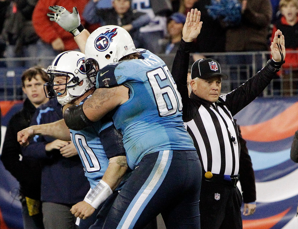 . Tennessee Titans quarterback Jake Locker (10) is hugged by tackle Mike Otto (66) after running 13 yards for a touchdown against the New York Jets in the third quarter of an NFL football game, Monday, Dec. 17, 2012, in Nashville, Tenn. (AP Photo/Wade Payne)
