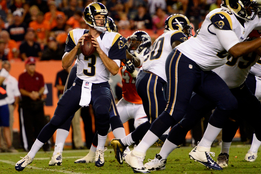 . DENVER, CO - AUGUST 24: Tim Jenkins (3) of the St. Louis Rams prepares to throw against the Denver Broncos during the second half of the Broncos\' 27-20 preseason game win at Sports Authority Field at Mile High on August 24, 2013. This is the third game of the preseason for the Broncos. (Photo by AAron Ontiveroz/The Denver Post)