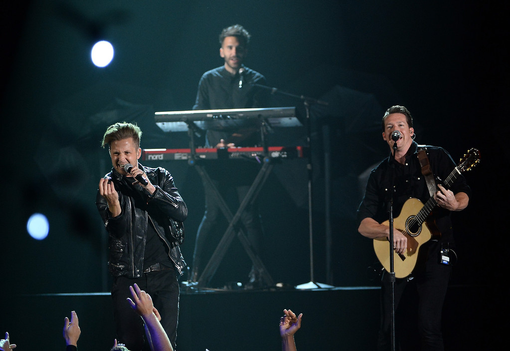 . Musicians Ryan Tedder, Brent Kutzle and Zach Filkins of OneRepublic perform onstage during the 2014 Billboard Music Awards at the MGM Grand Garden Arena on May 18, 2014 in Las Vegas, Nevada.  (Photo by Ethan Miller/Getty Images)