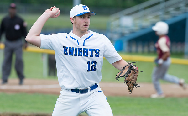 05/29/19 Wesley Bunnell | Staff Southington defeated New Britain 4-3 in 11 innings on a walk off single by Billy Carr (17) in the continuation of a game suspended in the 10th inning due to rain on May 29th. Pitcher Brendan Kavanaugh (12) fields a bunt and throws to first for the out.