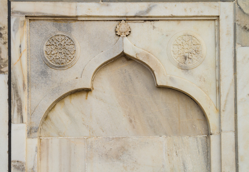 Details of the marble etching and craftsmanship at the Taj Mahal in the form of an arch.