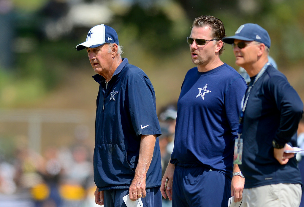 . Monte Kiffin, left, assistant head coach of defense and ex-USC defensive coordinator, watches the Cowboys-Raiders practice in Oxnard, Wednesday, August 13, 2014. (Photo by Michael Owen Baker/Los Angeles Daily News)
