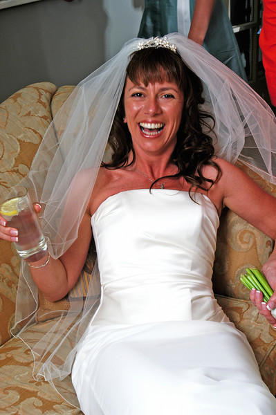 Bride having a G&T after the ceremony