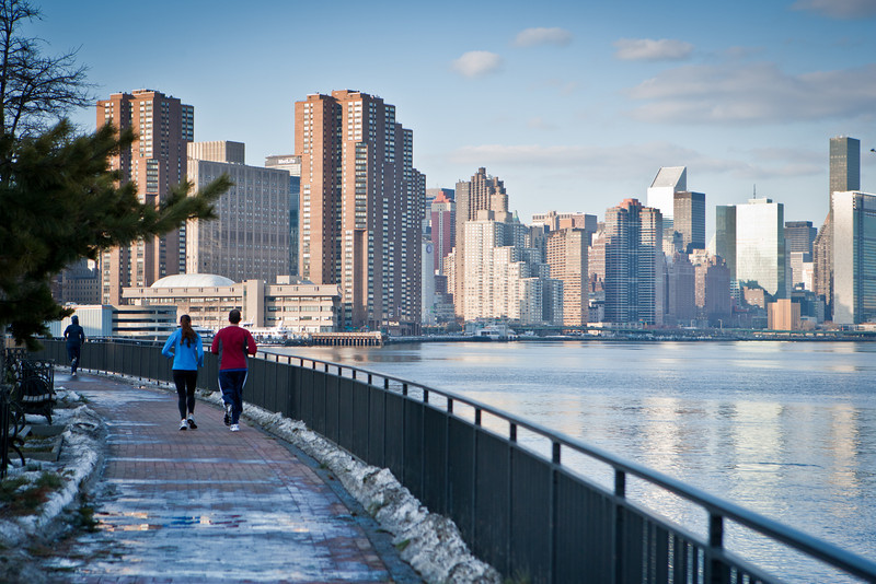 Jogging along the East River @ East River Park. A view of NYC.