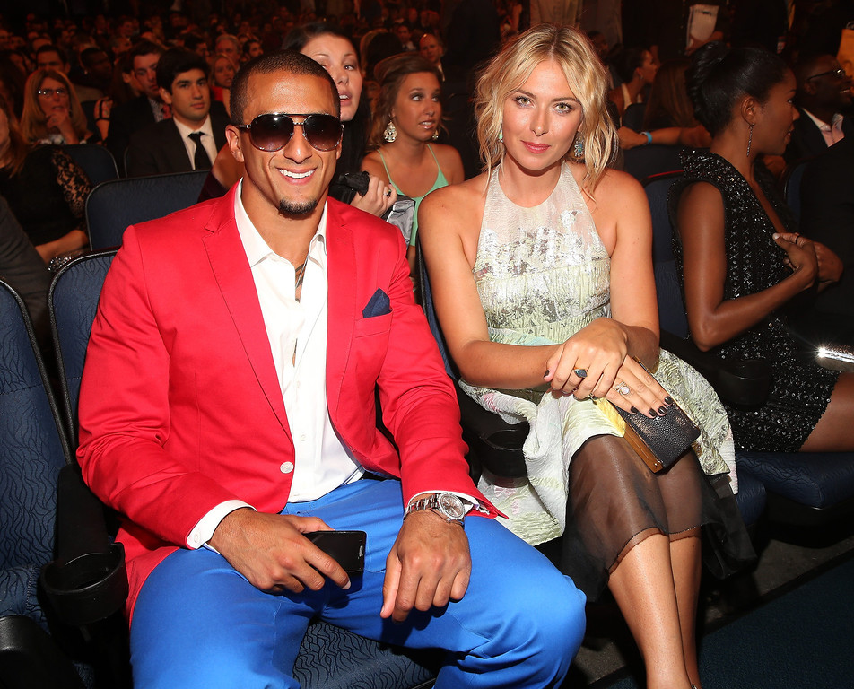 . NFL quarterback Colin Kaepernick (L) and Tennis player Maria Sharapova attend The 2013 ESPY Awards at Nokia Theatre L.A. Live on July 17, 2013 in Los Angeles, California.  (Photo by Christopher Polk/Getty Images for ESPY)