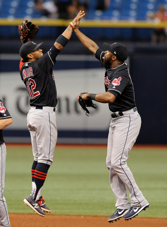 . Cleveland Indians\' Francisco Lindor, left, and Austin Jackson celebrate a win over the Tampa Bay Rays at the end of a baseball game Sunday, Aug. 13, 2017, in St. Petersburg, Fla. (AP Photo/Steve Nesius)